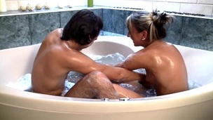 Horny blond whore and her fuckmate make out in the bathtub