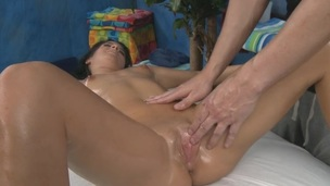 Close up where she oily slithering body is massaged fascinating