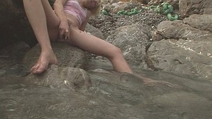 Freaky Alice rubbing against a rock to get her cookie soaked