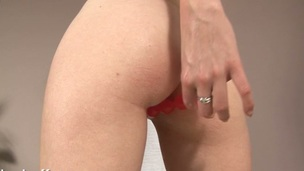 Nasty darling is stuffing the vacuum pipe into her cum-hole